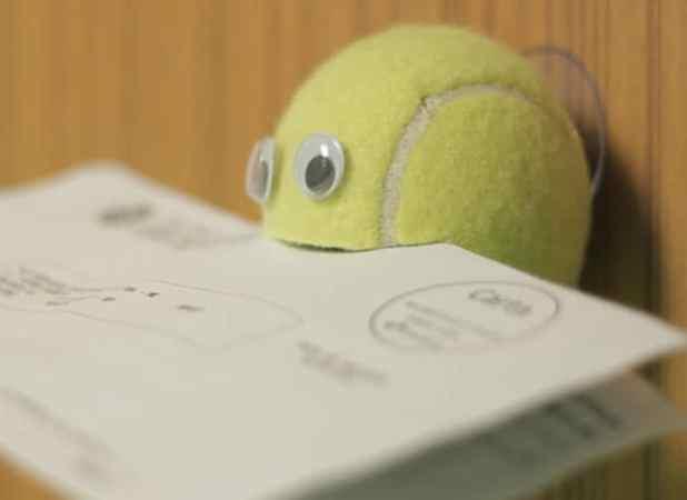 Porta-recado com bola de tênis