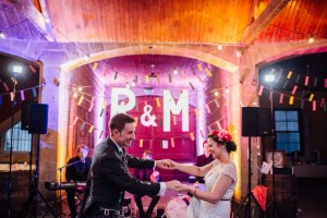 Wedding couple dances to ceilidh band