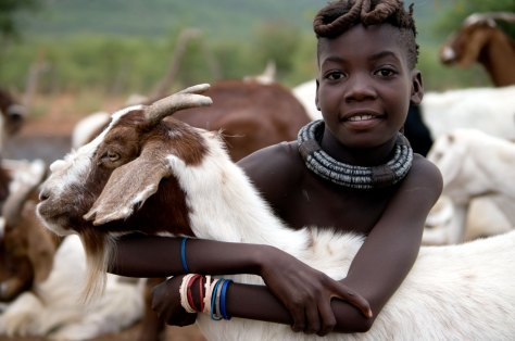 Himba girl with goat