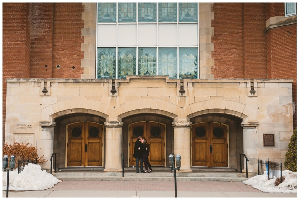 couple outside church in downtown regina engagement session