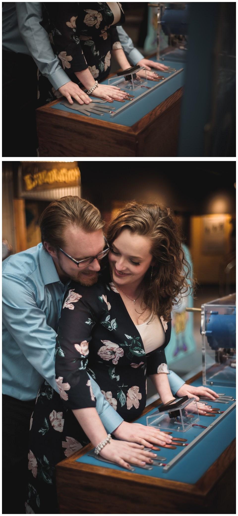 couple cuddling science centre engagement session regina