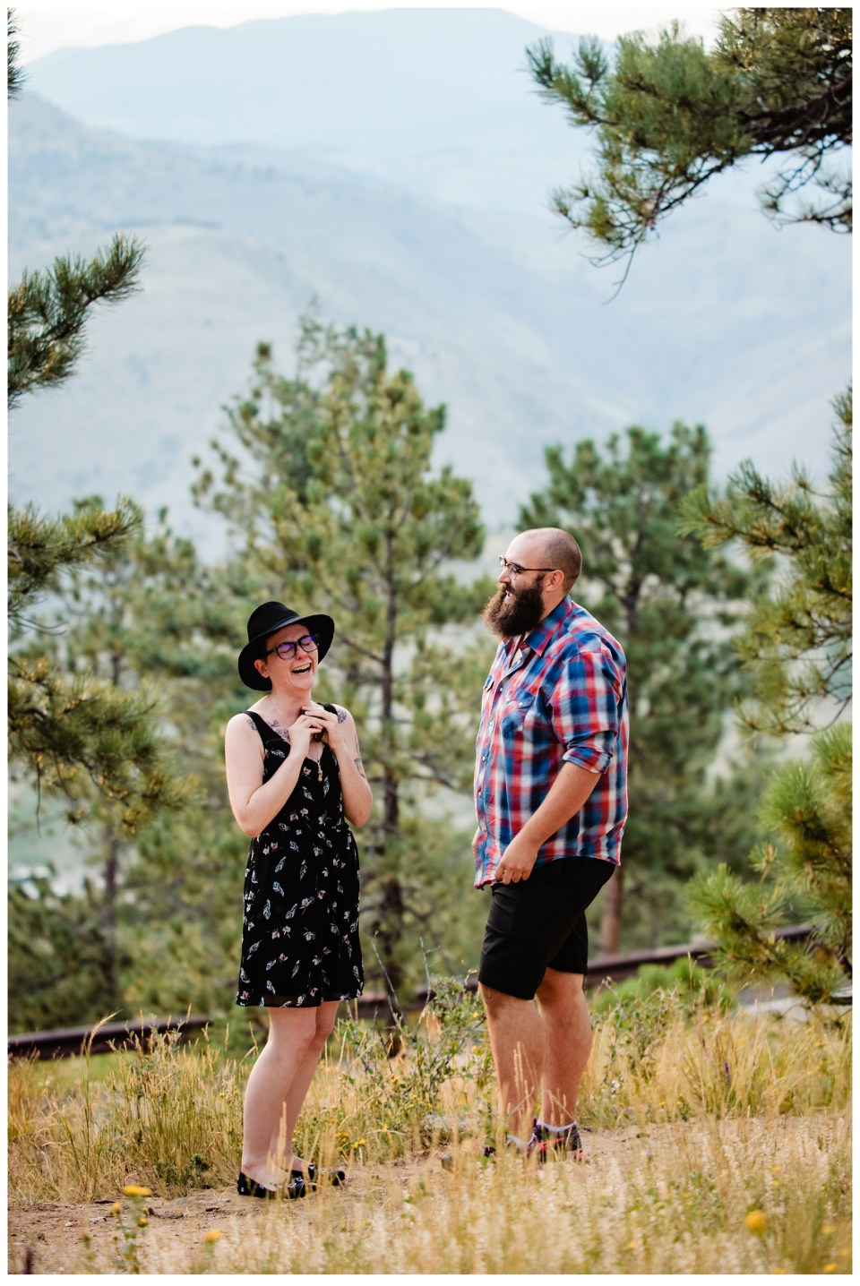 man proposing to his girlfriend on one knee in the mountains engagement story