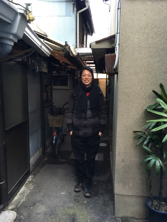 Go Tsushima outside his home/studio in the Baika area of Osaka