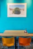 Local photographer Alison Vagnini's shots of Baja are printed directly onto plywood. | Photo Credit: Ruben Karel