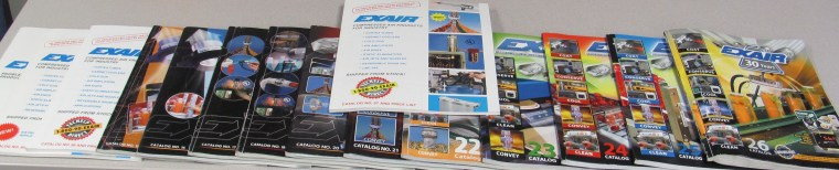 """A collection of EXAIR Catalogs, with """"Old # 97"""" right there in the middle (we don't really call it that)"""