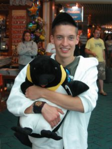 Sven, who loved penguins, with his stuffed penguin gift at Portland airport (June 2007)