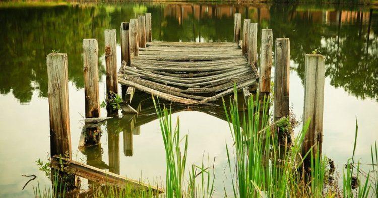 broken wooden bridge over water