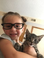 "Mr. August: After two years of a crazy cat obsession, Tiffany O.'s 4-year-old daughter finally got her wish: A new baby kitten they adopted at the Olathe, Kansas, Animal Shelter. Behold Biggie Smalls, a.k.a. ""The Notorious C.A.T."""