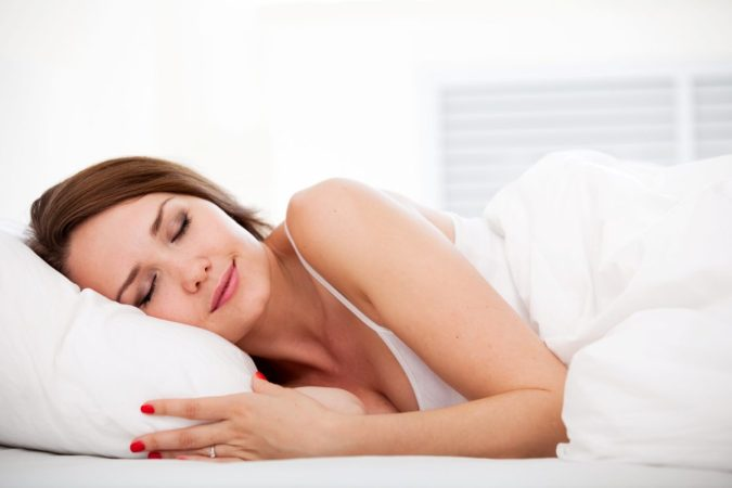 photo of woman sleeping peacefully on a new mattress