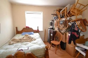 Guest room cluttered with chairs