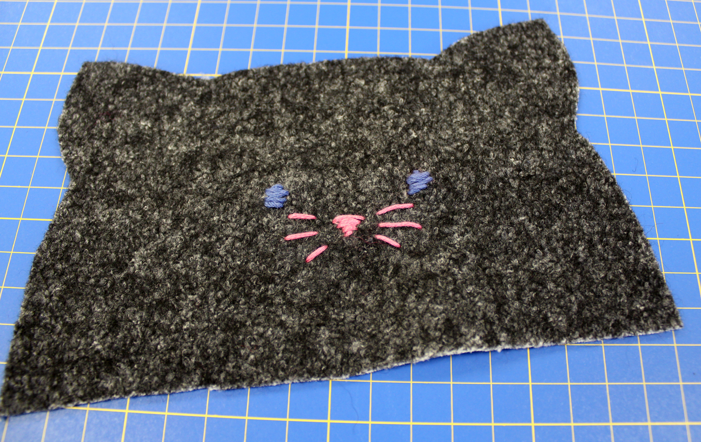 photo of the embroidered face for the kitty case zippered bag