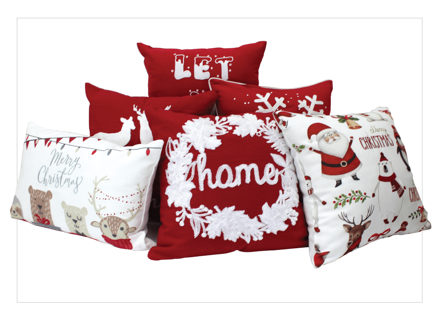 photo of Christmas holiday cushion covers in a red/white theme featuring santas, snowflakes, wreaths and winter characters