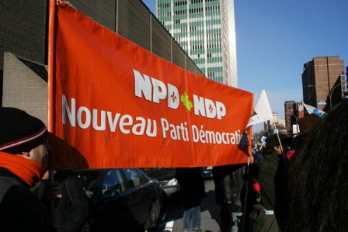 The NDP was represented by a big banner and kids in orange tuques