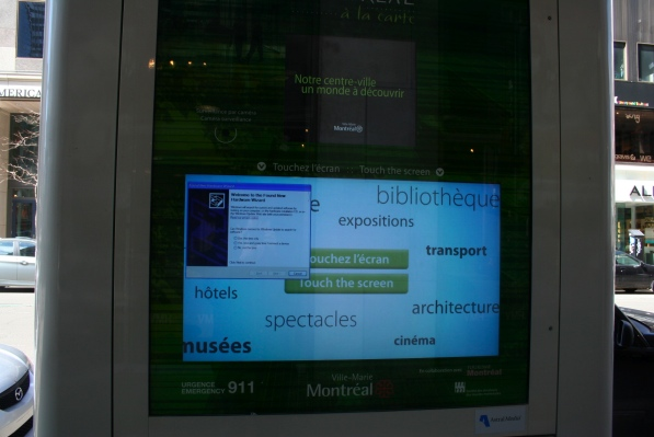 An information screen above a larger touch screen with tourist information