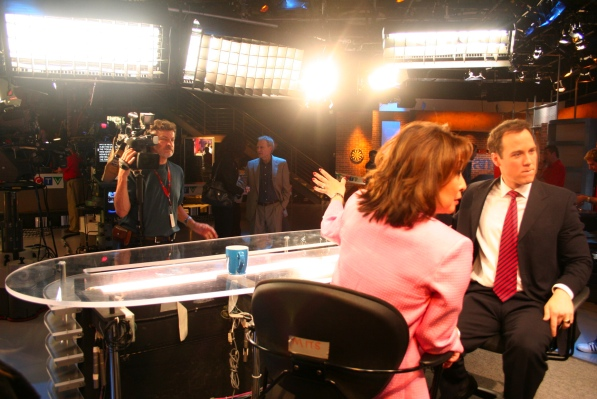 Blinding lights dominate the view from behind the desk.