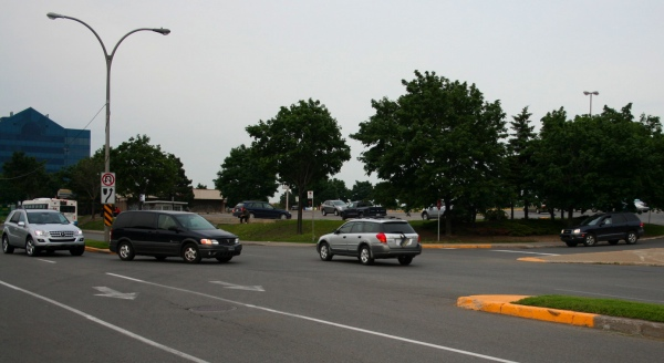This intersection has a lot of left-turning traffic who have to yield to oncoming vehicles from three different directions