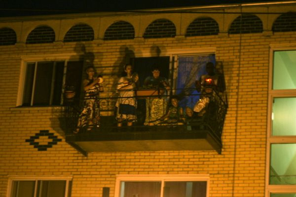 This group on a balcony was one of many to entertain cyclists with music as they passed by.