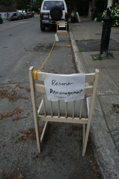 Chairs-with-string and grammatically incorrect signage implying authority which does not exist