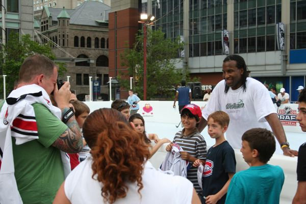 Laraque poses with kids for pictures outside the Bell Centre