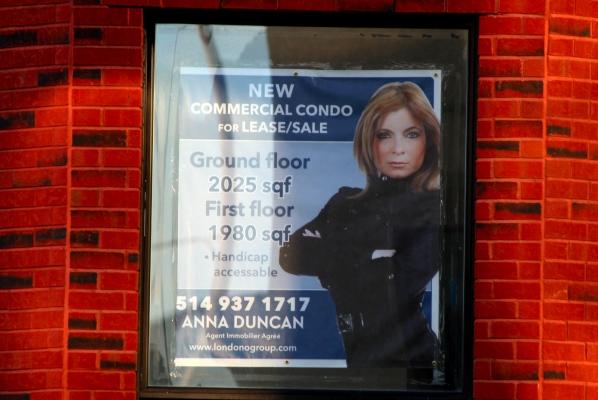Anna Duncan for sale sign on a building on de Maisonneuve Blvd.
