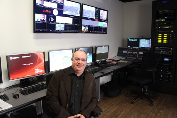 This is Murray Corbett, the operations manager. He's responsible for the technical production of the show. Here he is sitting in the hallway, which is lined with computers outside the control room.