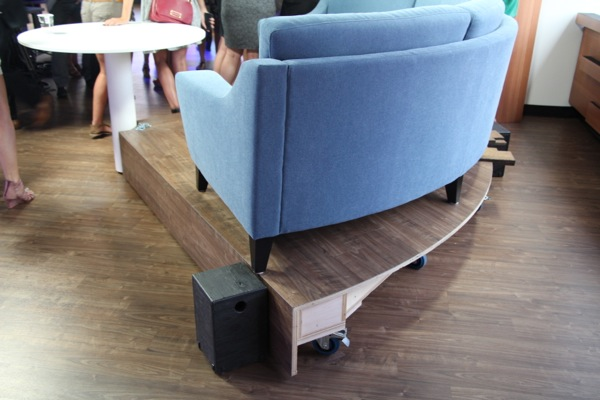 The couch sits on casters allowing it to be moved if necessary.