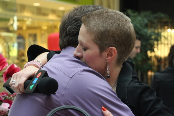 Christine Long gets a touching hug from her husband Serge.