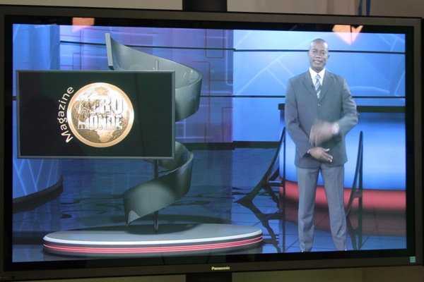 Afromonde host Henry Ngaka on his virtual set, as seen through a monitor in ICI's studio.