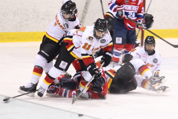 Calgary Inferno's Jacquie Pierri handles the puck through a pileup during a game in Montreal on Dec. 14.