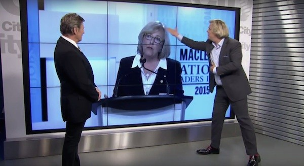 """Body language expert"" Mark Bowden, right, criticizes Elizabeth May's glasses and dress during OMNI's post-debate analysis show with Gord Martineau, left."