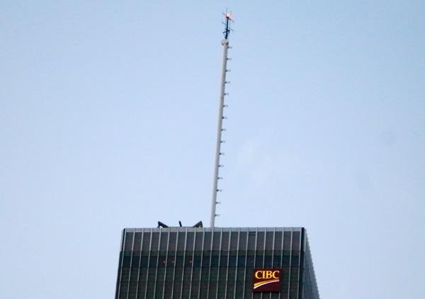 CKOI's current antenna atop the CIBC building