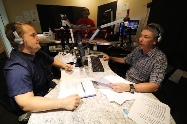 Elliott Price, right, with co-host Grant Robinson in the CFMB studio.