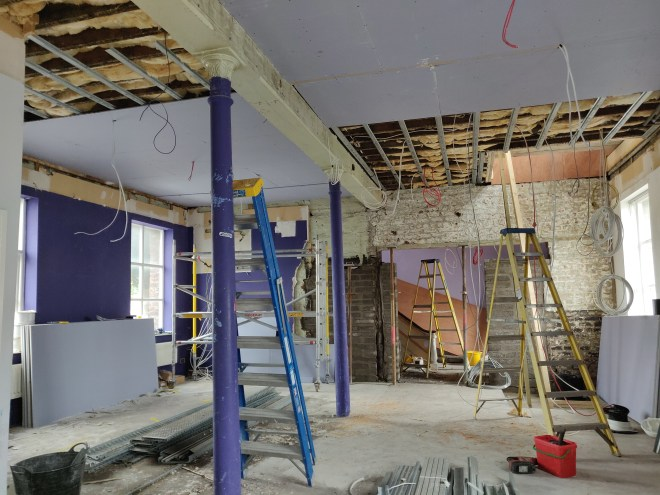 Looking at the mostly formed new entrance to the ground floor of Farset Labs. Ceiling partially covered by plasterboard. Masonry still being worked on.