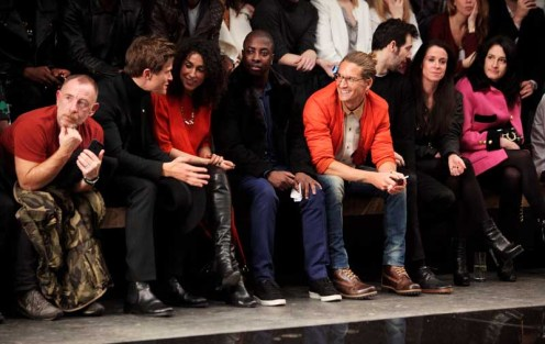 LONDON, ENGLAND - JANUARY 07: (L to R) Adrian Clark, Oliver Cheshire, guests, Oliver Proudlock, Ralf Little, Liberty Shaw and Amy Molyneaux sit in the front row during the Superdry AW14 catwalk event as part of London Collections: Men at The Old Sorting Office on January 7, 2014 in London, England. (Photo by David M. Benett/Getty Images for Superdry) *** Local Caption *** Adrian Clark; Oliver Cheshire; Oliver Proudlock; Ralf Little; Liberty Shaw; Amy Molyneaux