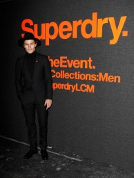 LONDON, ENGLAND - JANUARY 07: Oliver Cheshire arrives at the Superdry AW14 catwalk event as part of London Collections: Men at The Old Sorting Office on January 7, 2014 in London, England. (Photo by David M. Benett/Getty Images for Superdry) *** Local Caption *** Oliver Cheshire