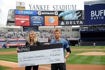 Buffalo David Bitton Spokespeople Kellan Lutz And Tori Praver Present A Check To The New York Yankees Foundation On Behalf Of The Brand