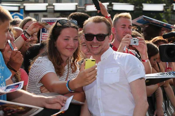 VIENNA, AUSTRIA - JULY 23: Simon Pegg takes selfies with fand during the world premiere of 'Mission: Impossible - Rogue Nation' at the Opera House (Wiener Staatsoper) on July 23, 2015 in Vienna, Austria. (Photo by Gisela Schober/Getty Images for Paramount Pictures International)