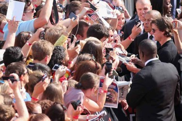 VIENNA, AUSTRIA - JULY 23: Tom Cruise signs autographs during the world premiere of 'Mission: Impossible - Rogue Nation' at the Opera House (Wiener Staatsoper) on July 23, 2015 in Vienna, Austria. (Photo by Gisela Schober/Getty Images for Paramount Pictures International)