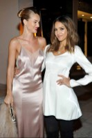 LOS ANGELES, CA - JANUARY 13: Model/actress Rosie Huntington-Whiteley (L) and actress Jessica Alba attend the Galvan For Opening Ceremony Dinner Hosted By Swarovski at Private Residence on January 13, 2016 in Los Angeles, California. (Photo by Donato Sardella/Getty Images for Galvan)