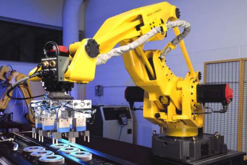 Chargement / Déchargement par robot sur convoyeur