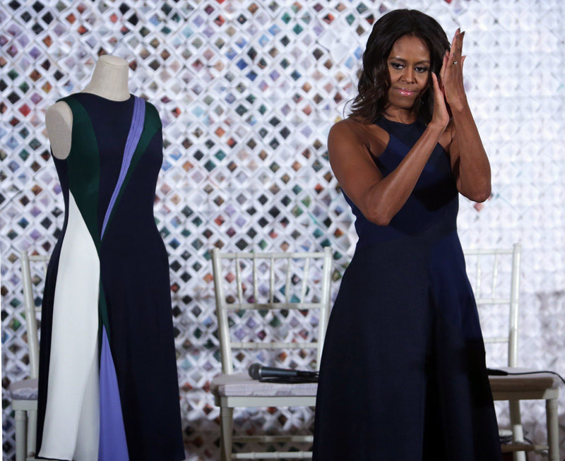 Chelsea Chen's dress on display next to First Lady wearing Natalya Koval's dress. Photo: Alex Wong/Getty Images