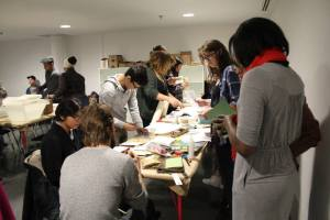 Bookbinding station manned by Fine Arts students