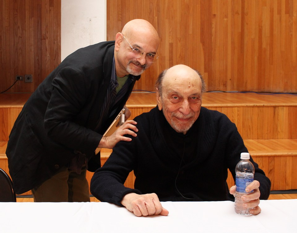 Milton Glaser seated, with Steven Heller
