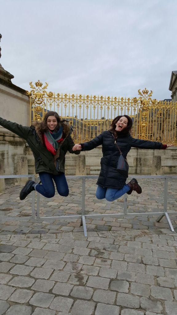 Jumping for joy outside of Versailles!