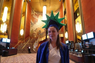 student wearing statue of liberty crown