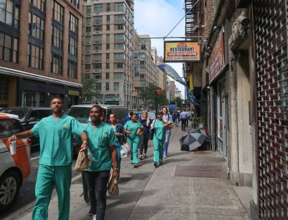 hospital workers walking down the street