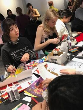 students assembling paper