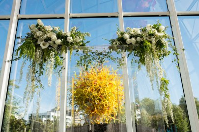 Beautiful white and orange spring wedding at Chihuly Seattle designed by Flora Nova Design