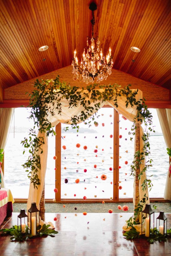 Flora Nova Design Seattle - Colorful Indian Wedding at the Edgewater Hotel. Draped Birch Ceremony Arch, with Flower Garland