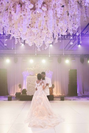 Beautiful white floral chandelier instillation suspended above the dance floor for this luxe ballroom Seattle wedding